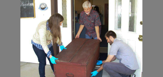 Chuck Dube helping curators from the Bullock Texas State History Museum remove the Kasper trunk for transport to Austin